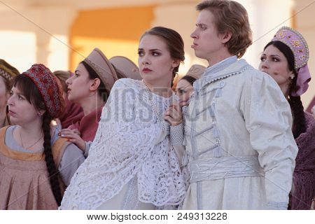 ST. PETERSBURG, RUSSIA - JULY 12, 2018: Olga Cheremnykh as Marfa (left) and Ilya Selivanov as Lykov in the opera The Thar's Bride outdoors during the festival All Together Opera