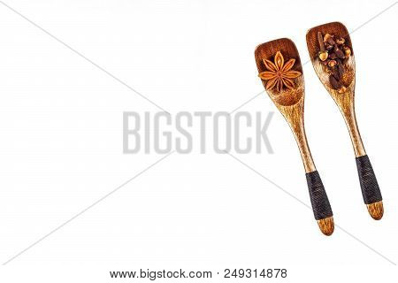 Badyan And Cloves On A Wooden Spoon, Isolated On White. Traditional Aromatic Spices. Smell Of Christ
