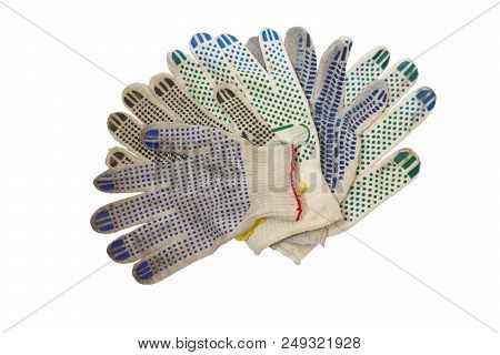 Heap Of Cotton Colorful Working Gloves With Rubber Dots, Beautifully Arranged By Palms-up, Isolated
