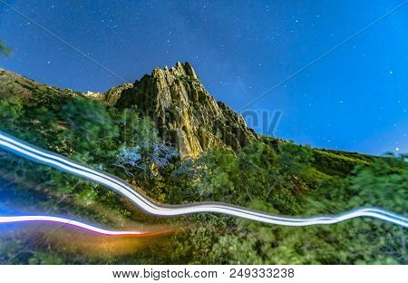 Two Light Trails From Hikers On Trail Of The Path To  Peak With Mountain In Background In Provo Utah