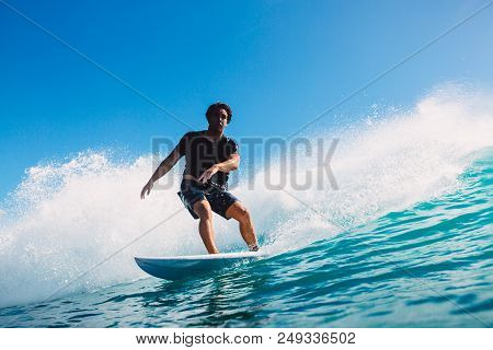 July 7, 2018. Bali, Indonesia. Surfer Ride On Big Barrel Wave At Padang Padang. Professional Surfing