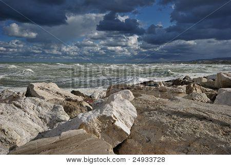 big mediterranean wave breaking the shore