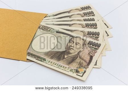Japanese Banknote 10,000 Yen In Brown Envelope For Give And Business Success And Shopping. Business