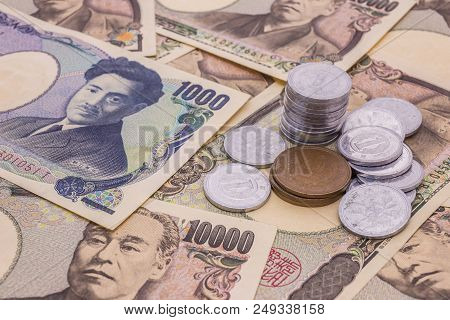 Closeup Of Japanese Yen Banknotes And Japanese Yen Coin Concept Background