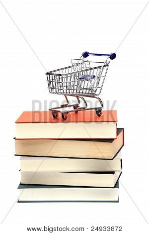 Shoppingcart On Top Of Books