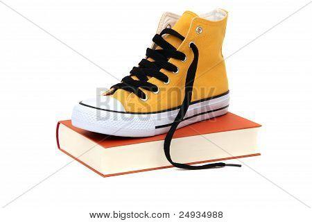 Yellow Sneaker On Book