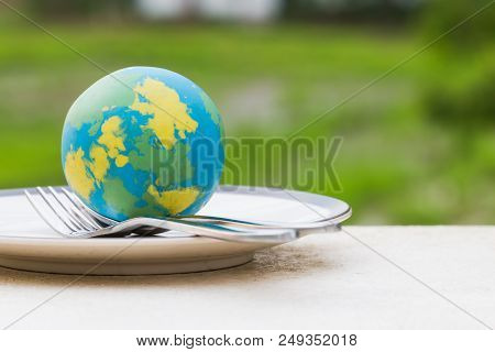 Globe Model Placed On Plate With Fork Spoon For Serve Menu In Famous Hotels. International Cuisine I