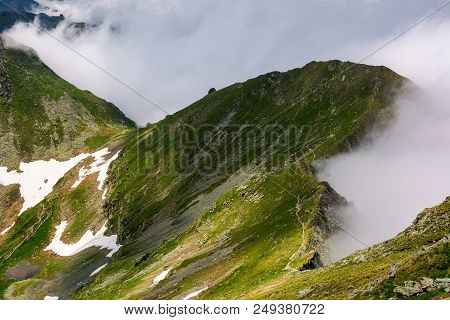 Mountainous Landscape On A Cloudy Summer Day. Beautiful Nature Scenery On High Altitude. Fagaras Mou