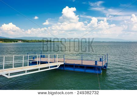 Blue Pier On Zemplinska Sirava Lake. Beautiful Landscape Of Slovakia With Gorgeous Cloudscape. Lovel