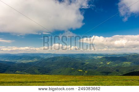 Beautiful Landscape Under The Summer Sky. Fluffy Clouds Over The Mountain Ridge. Pleasant Atmosphere