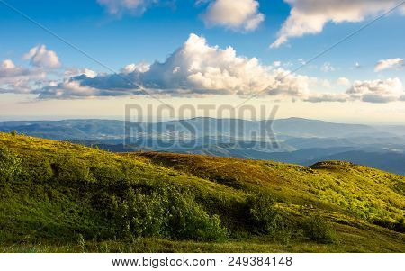 Beautiful Clouds Over The Summer Mountain Landscape. Grassy Hills And Distant Mountains In Evening S