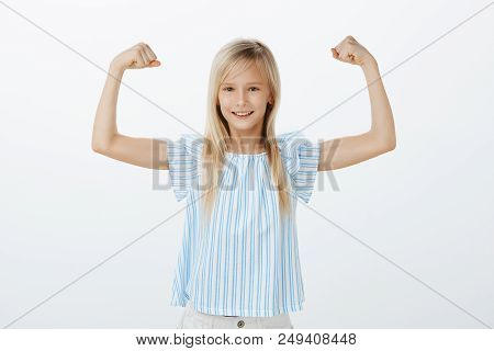 Someday Girl Become Famous Sportswoman. Little Confident Kid With Blond Hair In Blue Blouse, Raising
