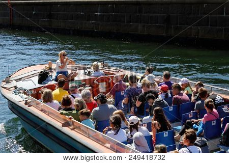 Copenhagen, Denmark - June 27, 2018: One Open Top Canal Tour Boat With Passengers On A Guided Sights
