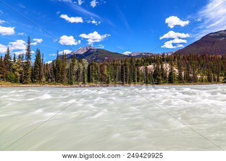 Rapidly Moving Waters Of Athabasca River Flowing Toward Athabasca Falls In Jasper National Park In A