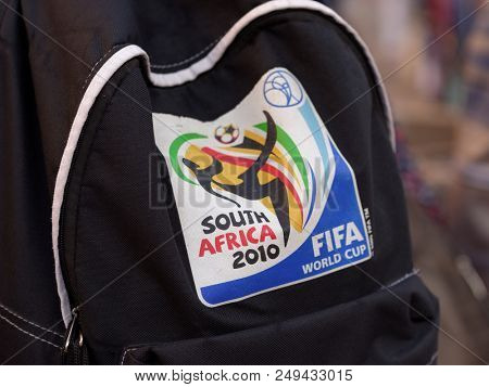 ST. PETERSBURG, RUSSIA - JULY 13, 2018: Logo of FIFA World Cup South Africa 2010 on the backpack of a football fan visited FIFA World Cup Russia 2018. Saint Petersburg host 7 matches of FIFA World Cup