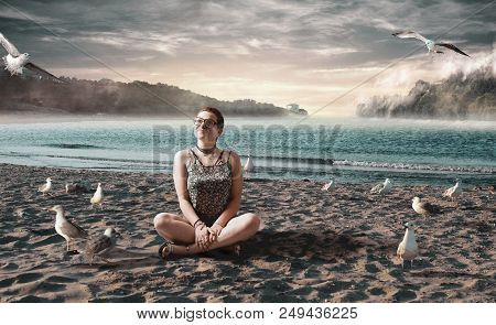 Young Girl On Beach Surrounded By Seagulls Admiring The View. Woman Relaxing On Tropical Beach.