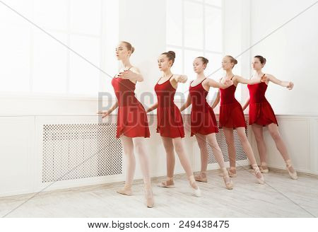 Young Girls Dancing Ballet In Studio. Choreographed Dance By A Group Of Graceful Pretty Young Baller