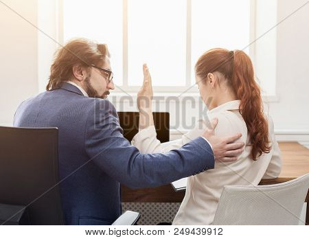 Sexual Harassment At Work, Lustful Boss Touching Young Woman In Office, Back View, Copy Space