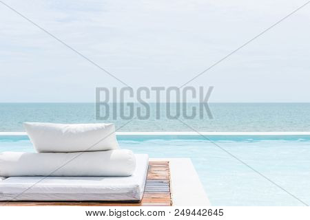 White Bed At Pool Seaside The Sea With Horizon Sky