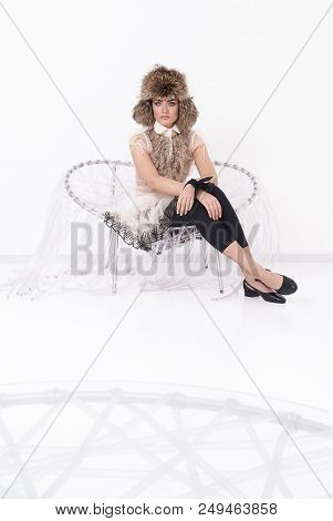 Portrait Of A Stunning Fashionable Model Sitting In A Chair In Art Nouveau Style. Fashion, Elegant F