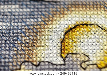 Cross-stitch. Macro Photography Of Embroidery Sites. Shooting With A Small Bluff Of Sharpness. Brigh
