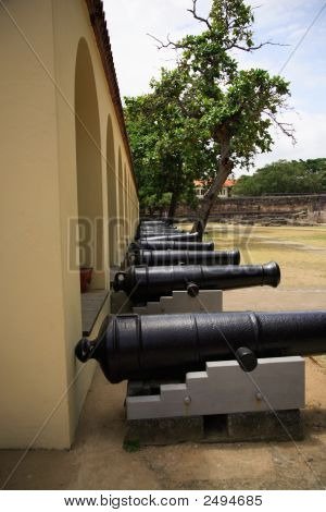 A row of cannons at Fort Jesus Mombasa Kenya Africa poster