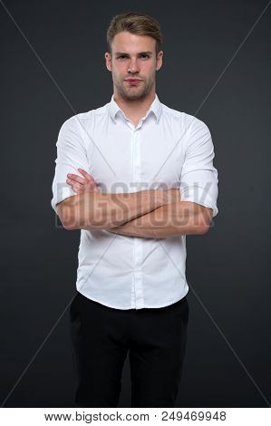 I Am Here To Help You. Man Shop Consultant Looks Confident And Hospitable. Man Calm Face Posing Conf