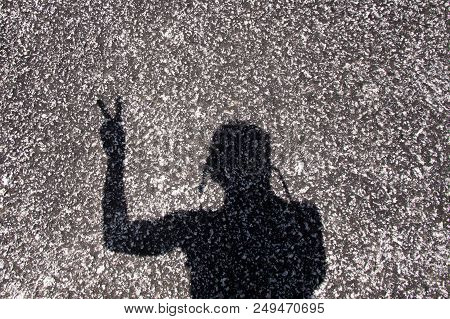 Shadow Of Victory Sign On Asphalt Road Background .
