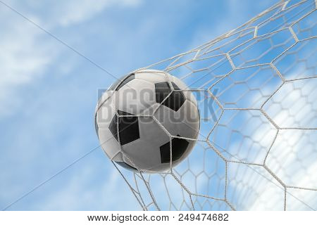 Soccer Ball On Goal With Net And Sky Background, This Photo Can Use For Football, Sport, Goal, Score