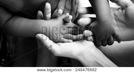 Touching Moment, Touch Of The Hand Of A Small Child And An Adult Woman. Mother And Child, Adoptive C