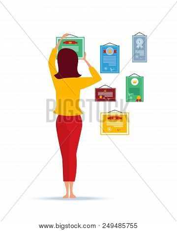 Girl Being At Home, Hangs On Her Wall The Next Letters And Awards For Merits On Work, Successes In S