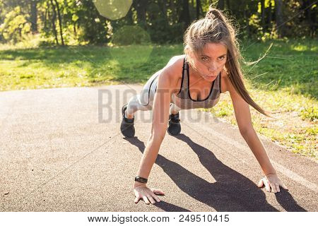 Fitness Woman Doing Push-ups During Outdoor Cross Training Workout. Beautiful Young And Fit Fitness