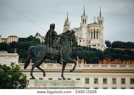 Equestrian Statue Of Louis Xiv On Place Bellecour In The Old Town Of Lyon.