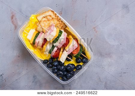 Healthy School Lunch Box With Sandwich Kabobs, Yogurt, Juice, Fruits And Berries