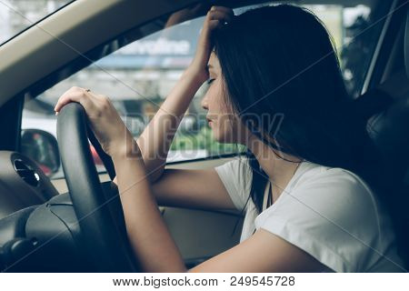 Stressed Woman Driver Sitting In Car Having Headache Stop After Driving Car In Traffic Jam On Rush H