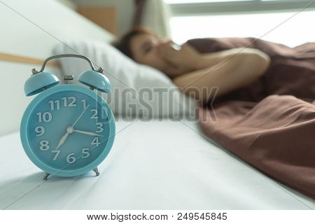 Young Woman Yawn Awakening Tired Holding Alarm Clock. Wake Up Early In Morning. Girl Stop Snooze Ala