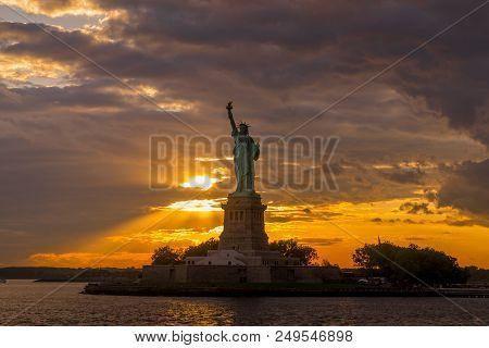 Beautiful Sunset Light Illuminates Statue Of Liberty In New York Harbor