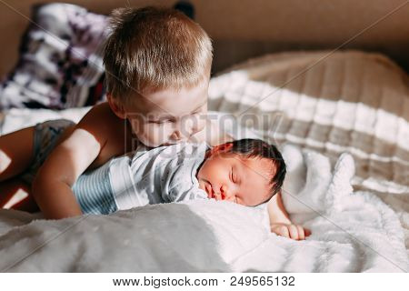 Elder Brother Kissing Newborn Baby Sister