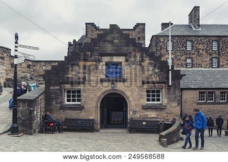 Edinburgh, Scotland - April 2018: Tourists Exploring Group Of Old Buildings Which House Museum Of Th