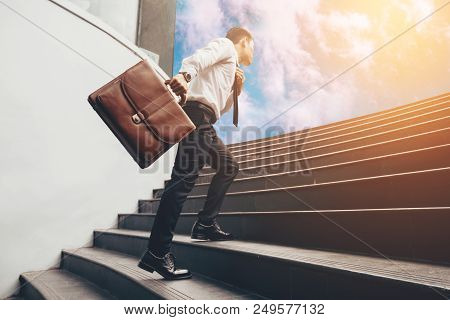 Young Businessman Upstair On Steps To Future.