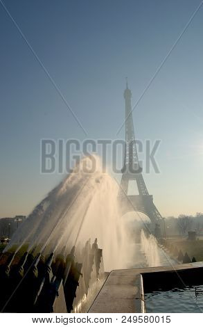 Architecture Of Paris, France, Famous Eiffel Tower In The Morningf