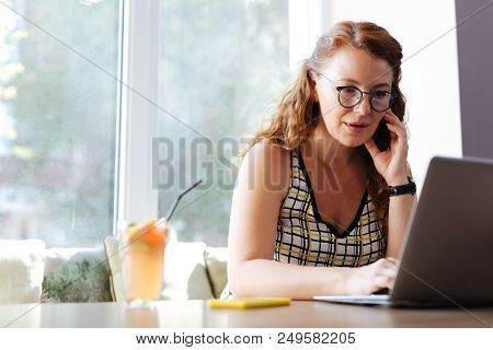 Calling Husband. Freelance Worker Wearing Stylish Colorful Blouse Calling Her Husband While Working