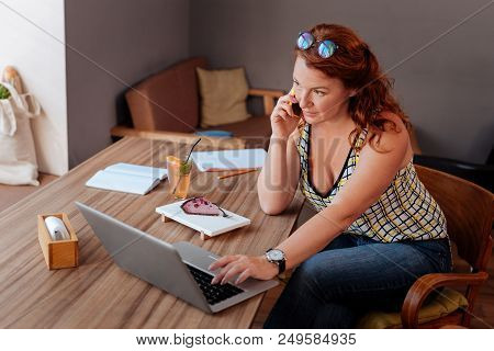 Meeting With Colleague. Busy Prosperous Businesswoman Calling Her Colleague While Having Meeting