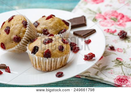 Homemade Cupcakes With Cherries Are Located On A Light Background. A Few Cupcakes Are Located On A W