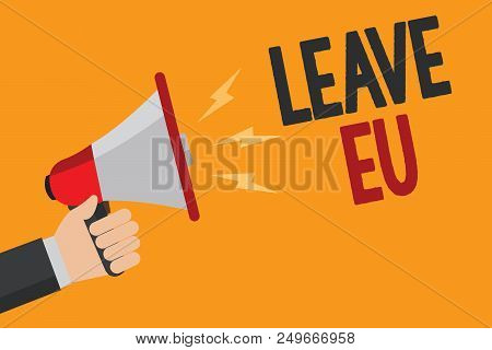 Handwriting text writing Leave Eu. Concept meaning An act of a person to leave a country that belongs to Europe Man holding Megaphone loudspeaker loud screaming talk talking speech listen poster