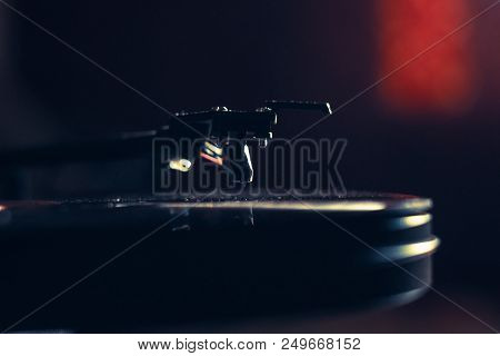 Vintage Record Player With Vinyl Disc, Close-up. Warm Sunlight