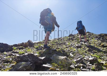 View On Two Climbers Hike Mount To Peak Of Mountain. Leisure Activity In Mountains. Hiking Sport In