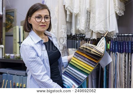 Female Designer, Interior Decorator, Store Owner Shows The Fabric. Small Business Textile Shop