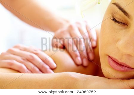 Close-up of calm female during luxurious procedure of massage poster
