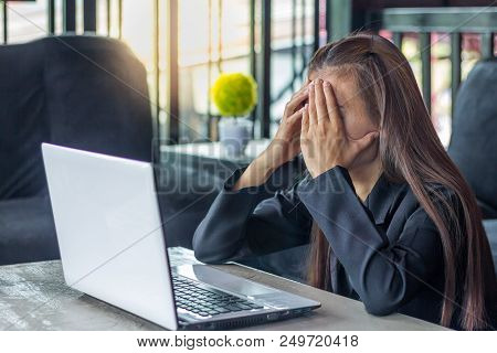 Business Woman Having Headache While Working Using Laptop Computer. Stressed And Depressed Girl Touc